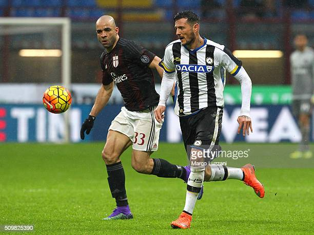 Cyril Thereau of Udinese Calcio competes for the ball with Alex Dias da Costa of AC Milan during the Serie A match between AC Milan and Udinese...