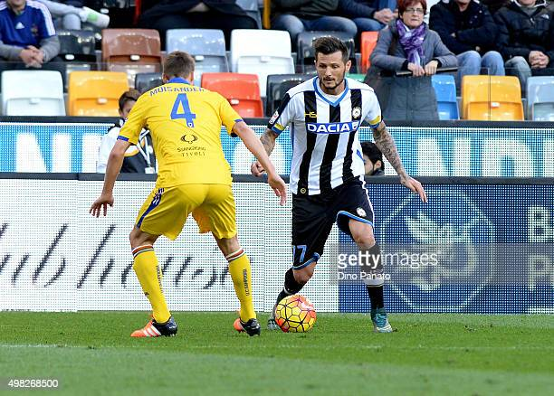 Cyril Thereau of Udinese Calcio competes with Niklas Moisander of UC Sampdoria during the Serie A match between Udinese Calcio and UC Sampdoria at...
