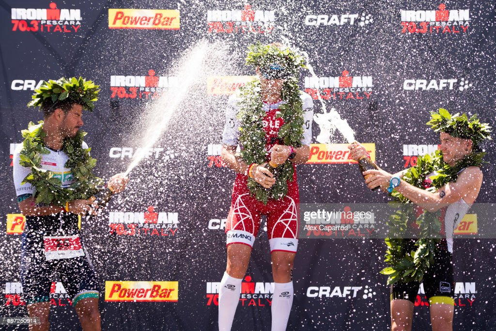 Cyril Viennot (C) of France in 1st place, Manuel Kung (L) of Switzerland in 2nd place and Albert Moreno (R) of Spain in 3rd place celebrate their positions after Ironman 70.3 Italy race on June 18, 2017 in Pescara, Italy.