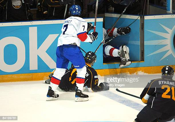 Cyrill Buhler of ZSC is pushed in by Juuso Puustinen of Espoo Blues during the IIHF Champions Hockey League semi-final match between Espoo Blues and...