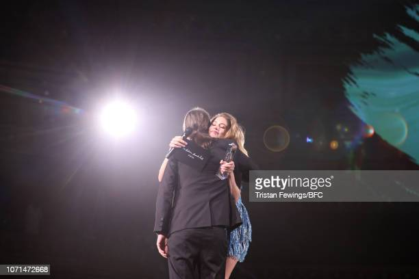 Cyrill Gutsch for Parley For The Oceans hugs award presenter Doutzen Kroes after receiving the Special Recognition Award for Innovation during The...