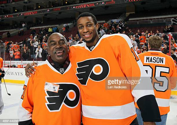Cyrill Simmonds the father of Wayne Simmonds of the Philadelphia Flyers pose for a photo following the father and son team photo after their game...