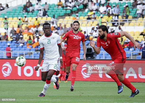 Cyrille Bayala of Burkina Faso vies with Syam Ben Youssef during the 2017 Africa Cup of Nations quarterfinal football match between Burkina Faso and...