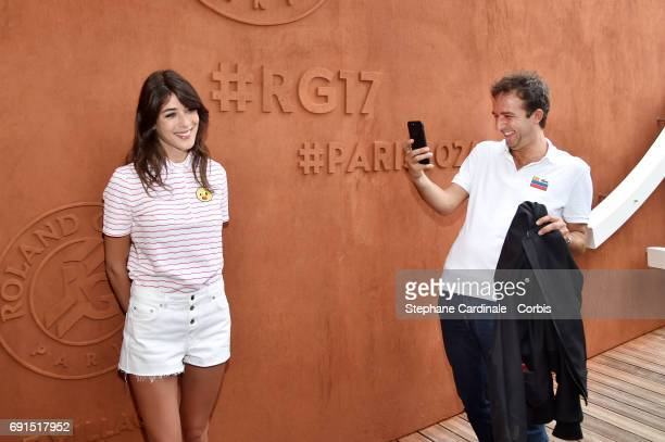 Cyrille Eldin and his companion Sandrine Calvayrac attend the 2017 French Tennis Open Day Six at Roland Garros on June 2 2017 in Paris France