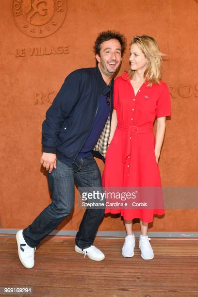 Cyrille Eldin and Margot Bancilhon attend the 2018 French Open Day Twelve at Roland Garros on June 7 2018 in Paris France