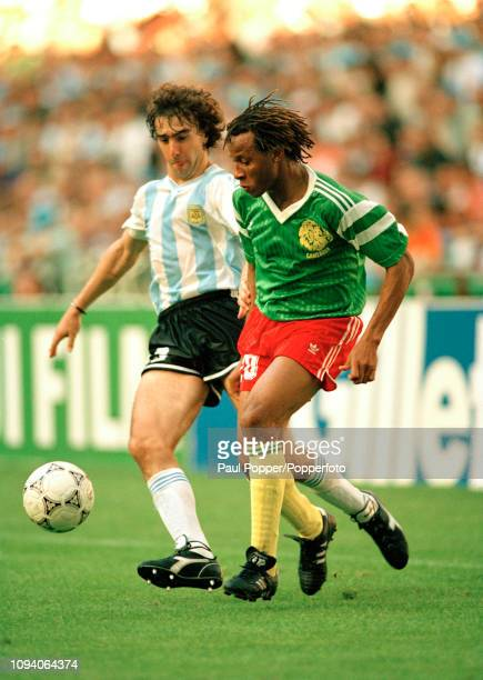 Cyrille Makanaky of Cameroon is challenged by Nestor Lorenzo of Argentina during a 1990 FIFA World Cup Group B match at the San Siro on June 8 1990...