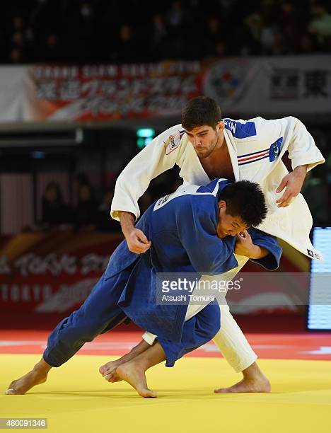 Cyrille Maret of France and Guham Cho of Korea compete in Men's 100kg final during Judo Grand Slam Tokyo 2014 at Tokyo Metropolitan Gymnasium on...