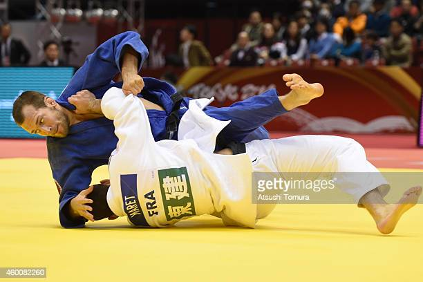 Cyrille Maret of France and Martin Pacek of Sweden compete in Men's 100kg semi final during Judo Grand Slam Tokyo 2014 at Tokyo Metropolitan...