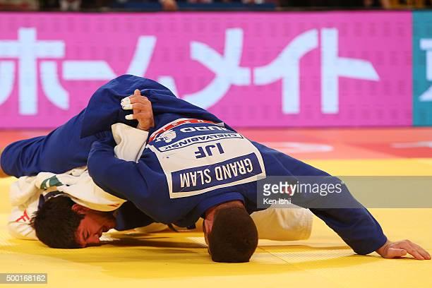 Cyrille Maret of France holds Beka Gviniashvili of Georgia for ippon in the Men's 100kg bronze medal match at Tokyo Metropolitan Gymnasium on...
