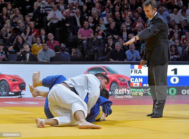 Cyrille Maret of France holds Kyle Reyes of Canada for an ippon to win the u100kg final and the gold medal during the Paris Grand Slam Sunday 7...