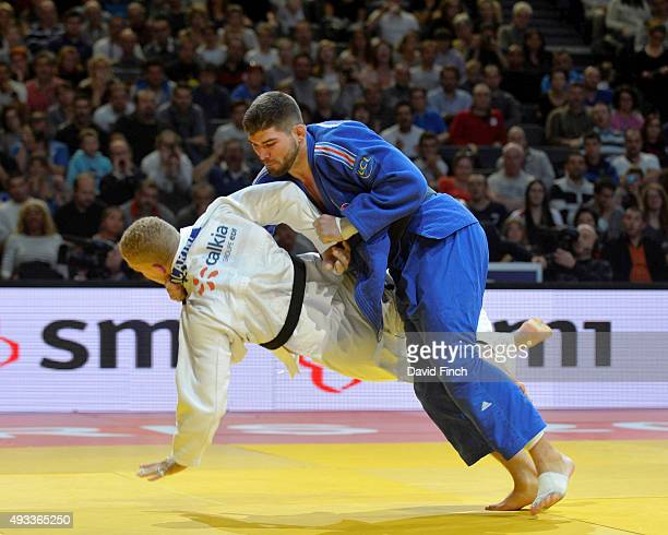 Cyrille Maret of France takes down Rafael Buzacarini of Brazil in the u100kg final to take the gold medal during the 2015 Paris Grand Slam at the...