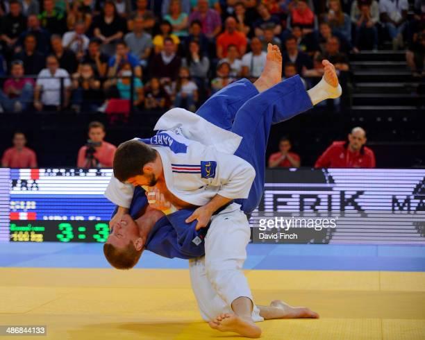 Cyrille Maret of France throws Flavio Orlik of Switzerland for a wazari during their u100kg contest won by Maret during the Montpellier European Judo...