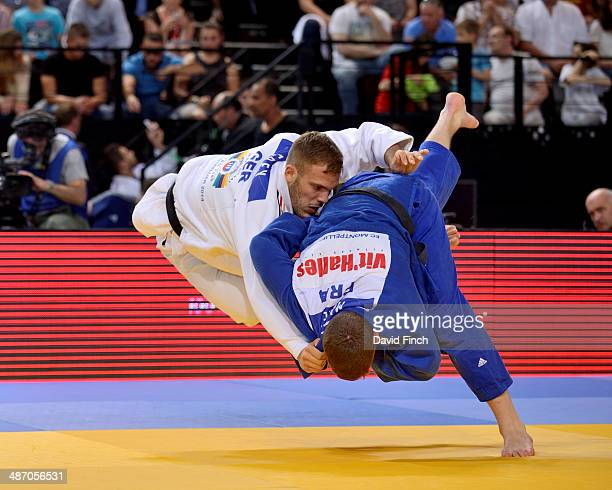 Cyrille Maret of France throws KarlRichard Frey of Germany for a yuko to win the u100kg bronze medal at the Montpellier European Judo Championships...