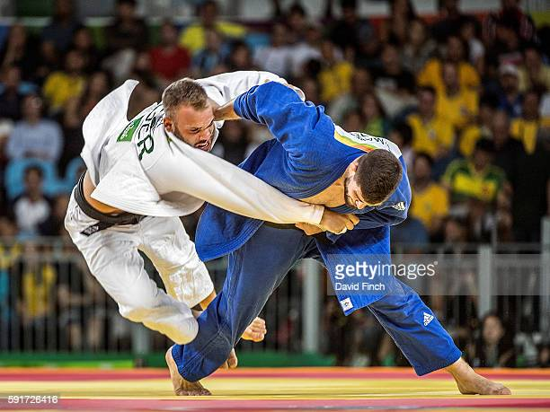 Cyrille Maret of France throws KarlRichard Frey of Germany for an ippon to win the u100kg bronze medal contest during day 6 of the 2016 Rio Olympic...
