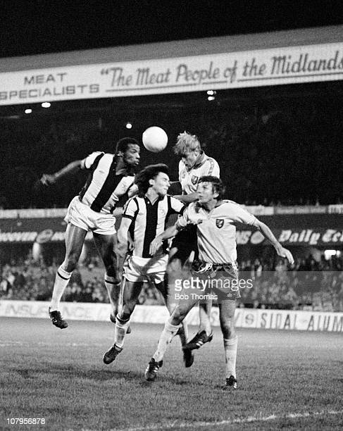 Cyrille Regis and Bryan Robson of West Bromwich Albion clash with Roger Brown and Martin Peters of Norwich City during their Division One match held...