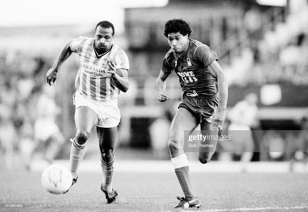 Cyrille Regis of Coventry City (left) races for the ball with Des Walker of Nottingham Forest during their Division One football match held at Highfield Road, Coventry on 8th November 1986. Coventry City beat Nottingham Forest 1-0. (Bob Thomas/Getty Images).