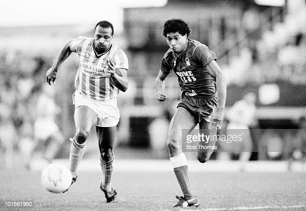 Cyrille Regis of Coventry City races for the ball with Des Walker of Nottingham Forest during their Division One football match held at Highfield...