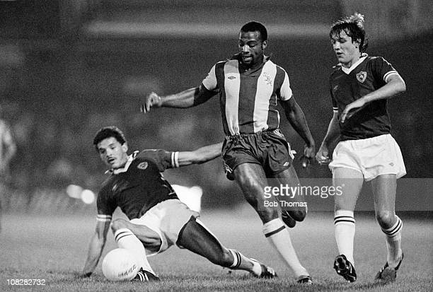 Cyrille Regis of West Bromwich Albion is challenged by Larry May and Alan Young of Leicester City during their League Cup 2nd round 2nd leg match...