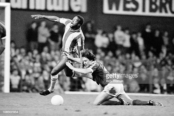 Cyrille Regis of West Bromwich Albion is fouled by Billy Wright of Everton during their League Cup 3rd round match held at Goodison Park Liverpool on...