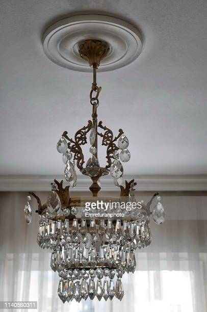 Cyrstal chandelier on a room ceiling