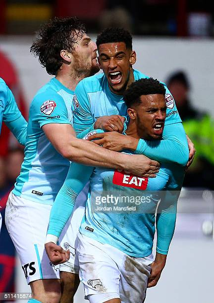 Cyrus Christie of Derby celebrates with his teammates after scoring his sides second goal during the Sky Bet Championship match between Brentford and...