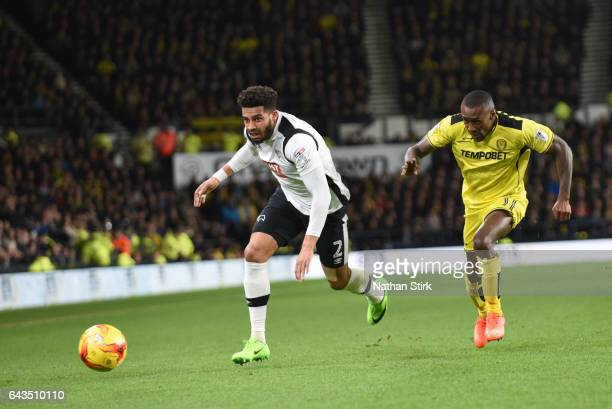 Cyrus Christie of Derby County and Lloyd Dyer of Burton Albion in action during the Sky Bet Championship match between Derby County and Burton Albion...
