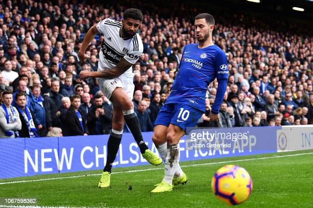 Cyrus Christie of Fulham and Eden Hazard of Chelsea in action during the Premier League match between Chelsea FC and Fulham FC at Stamford Bridge on...