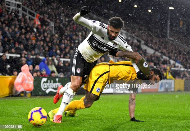 Cyrus Christie of Fulham battles for possession with Jurgen Locadia of Brighton and Hove Albion during the Premier League match between Fulham and...