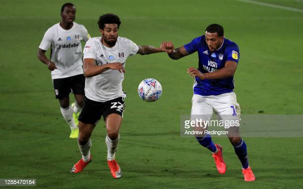 Cyrus Christie of Fulham is challenged by Nathaniel MendezLaing of Cardiff City during the Sky Bet Championship match between Fulham and Cardiff City...