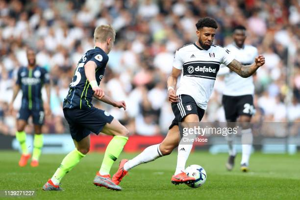 Cyrus Christie of Fulham is challenged by Oleksandr Zinchenko of Manchester City during the Premier League match between Fulham FC and Manchester...