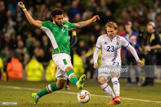 Cyrus Christie of Ireland Ari Freyr Skulason of Icelandduring the friendly match between Ireland and Iceland on March 28 2017 at the Aviva stadium in...