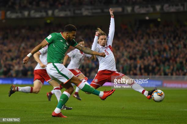 Cyrus Christie of Ireland shoots as Peter Ankersen of Denmark tries to block during the FIFA 2018 World Cup Qualifier PlayOff Second Leg between...