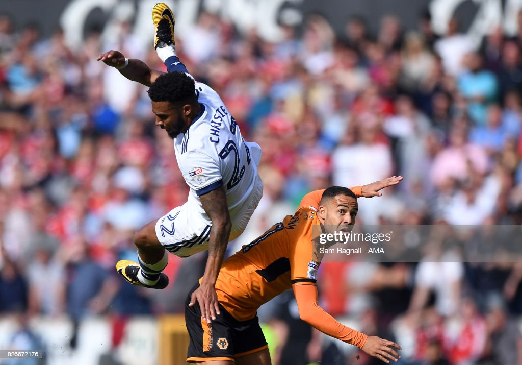 Cyrus Christie of Middlesborough and Jordan Graham of Wolverhampton Wanderers during the Sky Bet Championship match between Wolverhampton and Middlesbrough at Molineux on August 5, 2017 in Wolverhampton, England.
