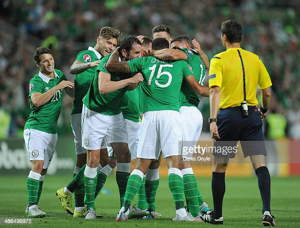 Cyrus Christie of Republic of Ireland celebrates with teammates after scoring Ireland's 1st goal during the UEFA EURO 2016 Qualifier between...