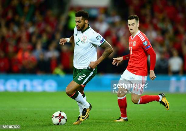 Cyrus Christie of the Republic of Ireland is chased by Tom Lawrence of Wales during the FIFA 2018 World Cup Group D Qualifier between Wales and...