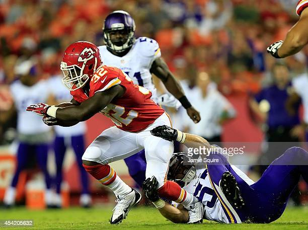Cyrus Gray of the Kansas City Chiefs carries the ball during the preseason game against the Minnesota Vikings at Arrowhead Stadium on August 23 2014...