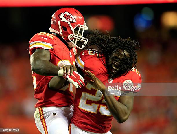 Cyrus Gray of the Kansas City Chiefs celebrates scoring a touchdown with Jamaal Charles against the Cincinnati Bengals at Arrowhead Stadium on August...