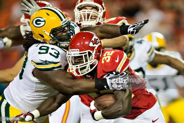 Cyrus Gray of the Kansas City Chiefs is tackled by Josh Boyd of the Green Bay Packers during the last preseason game at Arrowhead Stadium on August...