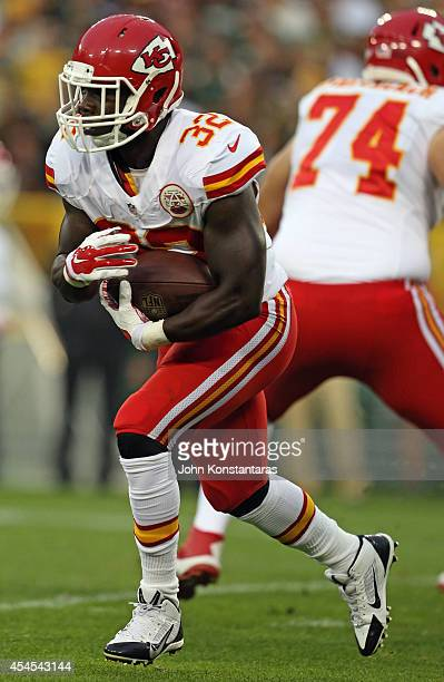 Cyrus Gray of the Kansas City Chiefs runs the ball during a preseason game against the Green Bay Packers on August 28 2014 at Lambeau Field in Green...