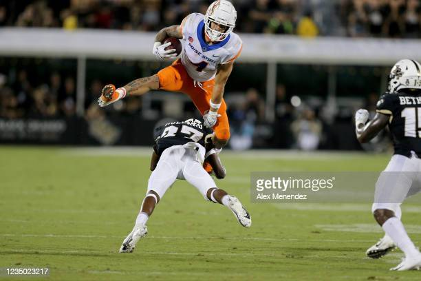 Cyrus Habibi-Likio of the Boise State Broncos attempts to leap over Quadric Bullard of the UCF Knights at the Bounce House on September 2, 2021 in...