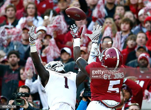 Cyrus Jones of the Alabama Crimson Tide breaks up this touchdown reception intended for De'Runnya Wilson of the Mississippi State Bulldogs at...