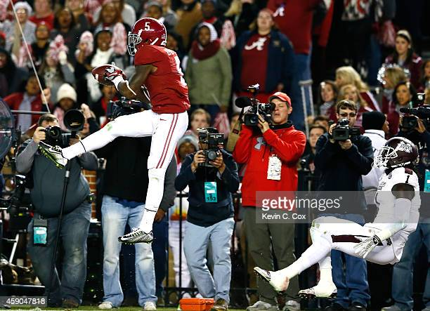Cyrus Jones of the Alabama Crimson Tide intercepts a touchdown reception intended for De'Runnya Wilson of the Mississippi State Bulldogs at...