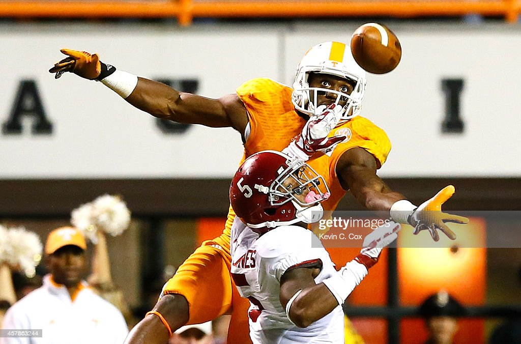 Cyrus Jones #5 of the Alabama Crimson Tide is flagged for pass interference as Marquez North #8 of the Tennessee Volunteers fails to pull in this reception at Neyland Stadium on October 25, 2014 in Knoxville, Tennessee.