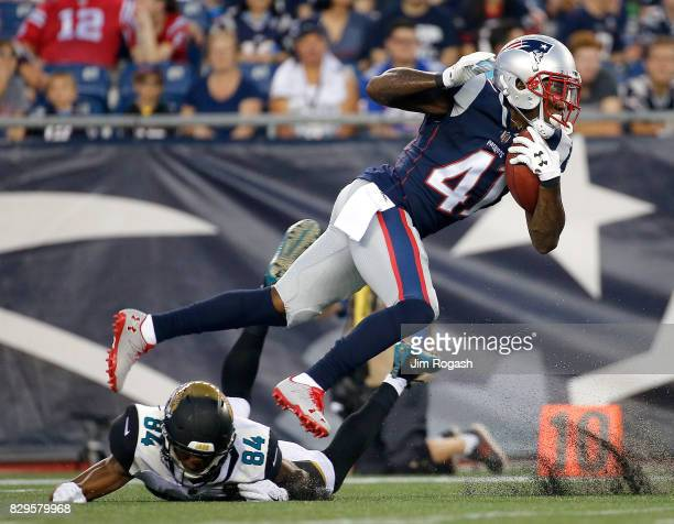 Cyrus Jones of the New England Patriots runs against the Jacksonville Jaguars in the first half of a preseason game at Gillette Stadium on August 10...