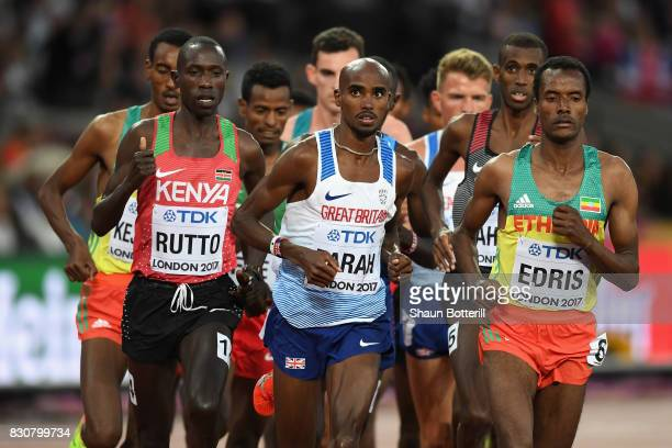 Cyrus Rutto of Kenya Mohamed Farah of Great Britain and Muktar Edris of Ethiopia compete in the Men's 5000 Metres final during day nine of the 16th...