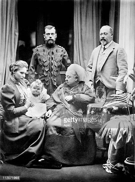 czar Nicolas II and his wife czarina Alexandra Fedorovna with their daughter Olga meeting queen Victoria and her son future king Edward II in 1896