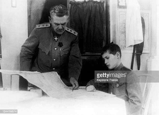Czarevich ALEXEI who was accompanying his father the Czar NICOLAS II of Russia to the military front pictured studying a map of the general staff...