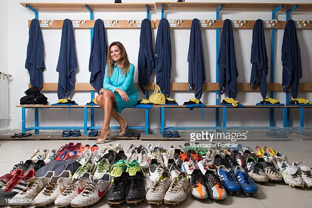 Czech actress Alena Seredova honorary president of the Carrarese football club posing in front of the players' football boots in the locker room of...