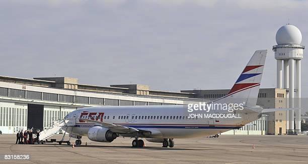 Czech Airlines passenger jet waits for take off outside the main terminal at Tempelhof airport in Berlin October 7, 2008. The airport, originally...