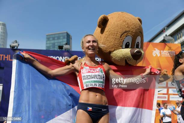 Czech athlete Eva VrabcováNývltová and mascot Berlino in the Womens Marathon final during day six of the 24th European athleteics Championships at...